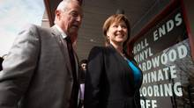 British Columbia Premier Christy Clark, right, and Surrey-Fleetwood candidate Peter Fassbender arrive for a rally where the B.C. Liberal party introduced their Surrey candidates in Surrey, B.C., on Tuesday March 26, 2013. (DARRYL DYCK For The Globe and Mail)