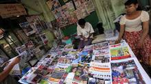 Vendors sit at a roadside newspaper and journals shop in Yangon April 1, 2013. Since 1963, Myanmar's government had banned private daily newspapers but with effect from Monday, the distribution of weekly news journals will be allowed on a daily basis. (Soe Zeya Tun/REUTERS)
