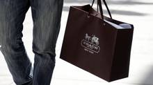 A shopping bag from the luxury brand Coach is seen along Rodeo Drive in Beverly Hills, Calif., in this May 21, 2013 file photo. (FRED PROUSER/REUTERS)