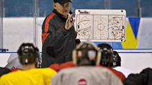 Team Canada head coach Lindy Ruff explains a drill during practice Friday, May 3, 2013 at the world hockey championship in Stockholm Sweden. Canada will play Denmark on their opening game on Saturday, May 4. (Jacques Boissinot/THE CANADIAN PRESS)