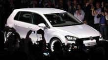 The new Volkswagen Golf is unveiled in Berlin in this file photo taken September 4, 2012. Volkswagen's fundamental rethink of vehicle platforms is helping power the German auto maker to the top of the global sales league table several years ahead of its 2018 target. (FABRIZIO BENSCH/REUTERS)