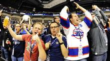 Winnipeg Jets' fans celebrate their team's first goal against the Montreal Canadiens' during the third period of their NHL hockey game in Winnipeg, Manitoba October 9, 2011. The Winnipeg Jets are playing their first season game since the franchise left the city 15 years ago. (TODD KOROL)