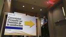 A sign points to the Charbonneau commission, a public inquiry into corruption within Quebec's construction industry, in Montreal September 17, 2012. The inquiry resumed on Monday after a three-month break. (CHRISTINNE MUSCHI/Reuters)