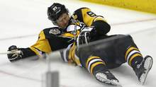 Sidney Crosby lies on the ice after taking a hit from Capitals defenceman Matt Niskanen during the first period of Game 3. (Gene J. Puskar/THE ASSOCIATED PRESS)