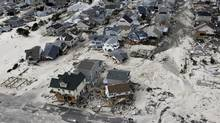 An aerial photo shows destroyed and damaged homes left in the wake of Superstorm Sandy in Seaside Heights, N.J., Oct. 31, 2012. The storm caused about $65-billion in damage. (Mike Groll/AP)