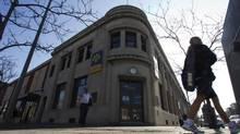 A pedestrian walks past a Laurentian Bank branch in Montreal. (CHRISTINNE MUSCHI/REUTERS)