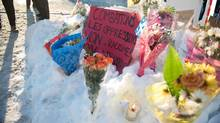 People place messages and flowers near a mosque that was the location of a shooting spree in Quebec City on Jan. 31, 2017. (ALICE CHICHE/AFP/Getty Images)