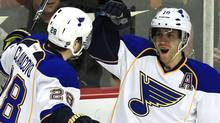 St. Louis Blues' center Andy McDonald (R) celebrates his goal with teammate Carlo Colaiacovo during the first period of their NHL hockey game against the Chicago Blackhawks in Chicago, March 13, 2012. REUTERS/Jim Young (Jim Young/Reuters)