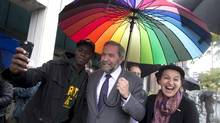 Tom Mulcair, campaigning in his home turf of Montreal on Friday, said of Stephen Harper that 'with his gruesome behaviour on race in this election campaign, I want nothing to do with his ilk.' (CHRISTINNE MUSCHI/REUTERS)