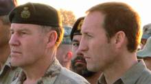 Chief of Defence Staff Walter Natynczyk and Defence Minister Peter MacKay attend a ramp ceremony for a fallen soldier at Kandahar airfield, Afghanistan, on Dec. 27, 2008. (Steve Rennie/The Canadian Press)