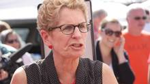 Liberal Leader Kathleen Wynne is seen at a farmer's market in Waterdown, Ont., on June 7 as she campaigns for the June 12 election. (COLIN PERKEL/THE CANADIAN PRESS)