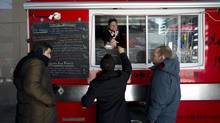 The Dobro Jesti food truck, owned by Jim and Lori Godina, serves up schnitzel sandwiches in Toronto March 18, 2014. (Kevin Van Paassen/The Globe and Mail)