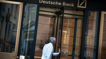A man enters the Deutsche Bank AG office building on Wall Street in New York, U.S., on Monday, Oct. 17, 2016. (Mark Kauzlarich/Bloomberg)