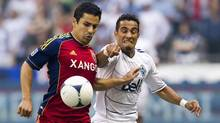 Vancouver Whitecaps' Camilo (R) fights for the ball against Tony Beltran of Real Salt Lake FC during the first half of their MLS soccer game in Vancouver, British Columbia August 11, 2012. (BEN NELMS/REUTERS)