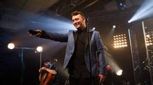 "Sam Smith performs in a private show at the iHeartRadio Theater for an intimate group of fans in New York City. The performance featured his latest single ""Stay With Me"" from his debut album, ""In the Lonely Hour,"" which will be released June 17, 2014. (Roger Kisby/AP)"