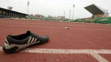 A shoe is seen inside the Port Said stadium one day after soccer supporters clashed February 2, 2012. Seventy-four people were killed when supporters clashed at an Egyptian soccer match, prompting fans and politicians on Thursday to turn on the ruling army for failing to prevent the deadliest incident since Hosni Mubarak was ousted. (MOHAMED ABD EL GHANY/Reuters)