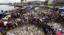 Victims queue for food and water in the aftermath of super typhoon Haiyan in Tacloban city, central Philippines November 14, 2013. (ERIK DE CASTRO/REUTERS)