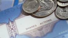 US coins on top of share certificates (Stockbyte/(c) Stockbyte)