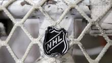The NHL logo is seen on a goal at a Nashville Predators practice rink on Sept. 17, 2012. The NHL locked out its players at midnight Saturday, the fourth shutdown for the NHL since 1992. (Mark Humphrey/AP)