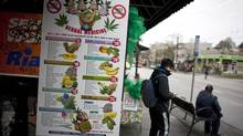 People wait for the bus outside the Health Lifestyle Marijuana Supply Centre on Commercial Drive in Vancouver, British Columbia, Thursday, January 22, 2015. (Rafal Gerszak for The Globe and Mail)