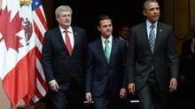 Prime Minister Stephen Harper, left to right, walks with Mexican President Enrique Pena Nieto and US President Barack Obama as they arrive to a trilateral meeting during the North American Leaders Summit in Toluca, Mexico on Wednesday, February 19, 2014. (Sean Kilpatrick/THE CANADIAN PRESS)