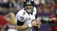Baltimore Ravens quarterback Joe Flacco rolls out against the San Francisco 49ers during the first quarter in the NFL Super Bowl XLVII football game in New Orleans, Louisiana, February 3, 2013. (SEAN GARDNER/REUTERS)
