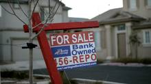 In this Feb. 8, 2008 file photo, a for sale sign stands in front of a bank-owned home in Las Vegas. (Jae C. Hong/AP)