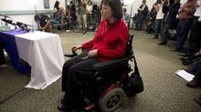 Elayne Shapray, who suffers from multiple sclerosis, arrives for a news conference in Vancouver, Oct. 29, 2013. Shapray and the British Columbia Civil Liberties Association made a urgent plea to have a choice in how to die. (JONATHAN HAYWARD/THE CANADIAN PRESS)