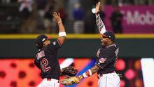 Francisco Lindor and Rajai Davis celebrate after defeating the Boston Red Sox 6-0 in Game 2. (Jason Miller/Getty Images)