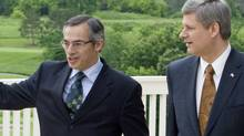 Prime Minister Stephen Harper walks with Industry Minister Tony Clement before making an announcement in Huntsville, Ont., on June 19, 2008. (Adrian Wyld/The Canadian Press)