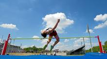 Lexi Aitken of St. Anne's Catholic Secondary School in Clinton, Ontario attempts to clears 1.64 meters during the midget girls' high jump at the Western Ontario Secondary School Athletic Association (WOSSAA) meet in London, Ontario, May 24, 2012. Aitken won the event with a jump of 1.60 meters/ (Geoff Robins/The Globe and Mail/Geoff Robins/The Globe and Mail)