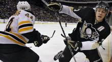 Boston Bruins' Dennis Seidenberg, left, checks Pittsburgh Penguins' Evgeni Malkin, of Russia, into the boards in the second period of an NHL hockey game in Pittsburgh, Sunday, March 7, 2010. (AP Photo/Keith Srakocic) (Keith Srakocic)
