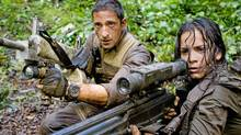 Royce (Adrien Brody) and Isabelle (Alice Braga) take aim during their desperate battle against the aliens. (Rico Torres)