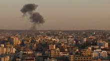 Smoke rises following an Israeli attack against Gaza City on Nov. 15, 2012. (Hatem Moussa/AP)