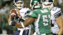 Toronto Argonauts quarterback Trevor Harris looks to make a pass while playing against the Saskatchewan Roughriders during the second half of their CFL football game in Regina, Saskatchewan July 26, 2014. (© David Stobbe / Reuters/REUTERS)