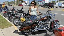 Jessica Phillips with a 2007 Harley Davidson Road King.