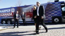 Conservative Leader Stephen Harper walks with his wife Laureen during a campaign stop in Brampton, Ont. (Chris Wattie/Reuters)