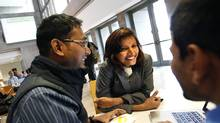 Sonali Dash, centre, an MBA student from India, chats with fellow MBA students Purnendu Nayak, left, and Sri Harsha, also from India while on break at York University's Schulich School of Business in Toronto. (Deborah Baic/Deborah Baic/The Globe and Mail)