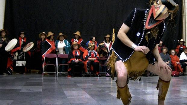 A Haida performer dances in a ceremony at Chicago's Field Museum on Oct. 17, 2003, to mark the museum's return of about 150 Haida human remains to the their descendants.