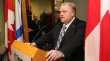 Toronto Mayor Rob Ford talks to the media during a press conference on his first day as a mayor (Fernando Morales/Fernando Morales/The Globe and Mail)