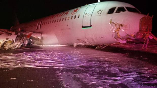 This March 29, 2015 handout photo provided by the Canada Transportation Safety Board shows a side view of a Air Canada Airbus A-320 after skidding off the runway at Halifax International Airport in Halifax, Nova Scotia. An Air Canada jet came off the runway after landing at the Halifax airport in Nova Scotia on March 29, sending at least 23 people to hospital, officials said. (AFP PHOTO / HANDOUT / CANADA TRANSPORTATION SAFETY BOARD)