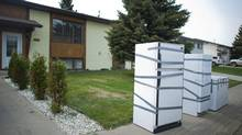 Discarded refrigerators, full of spoiled food, await pick up in Slave Lake, Alta., on Friday, May 27, 2011, after evacuees returned home. (John Ulan/THE CANADIAN PRESS)