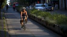 Safety is important for any bicycle commuter but the correct clothing, shoes and attitude should be along for the ride, too. (Ben Nelms/The Globe and Mail)