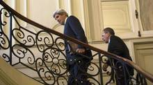 U.S. Secretary of State John Kerry, followed by Russian Foreign Minister Sergei Lavrov, ascend the steps of the Russian Ambassador's Residence for their meeting in Paris, Wednesday, March 5, 2014. (Kevin Lamarque/Associated Press)