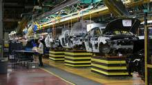 Today's car plants have one-third as many human workers as they did 20 years ago. (Peter Cheney/The Globe and Mail)