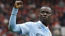Manchester City's Mario Balotelli celebrates after scoring against Manchester United during their English Premier League soccer match at Old Trafford in Manchester on Sunday. (DARREN STAPLES)