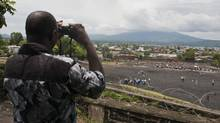 Modest Etoy of the Goma Volcano Observatory watches the active Mount Nyiragongo volcano in Goma, Democratic Republic of the Congo. (Erin Conway-Smith for The Globe and Mail)
