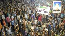 Demonstrators protest against Syria's President Bashar al-assad as they hold posters of men who they say were killed by pro-government security, in Dael near Deraa May 28, 2012. (REUTERS/Shaam News Network)