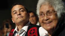 The current Chief of The Assembly of First Nations, Shawn Atleo, looks on while his great aunt, Gertrude Frank, is all smiles after the results of the first ballot are announced. (Peter Power/The Globe and Mail)
