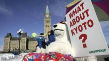 A Greenpeace activist dressed in a polar bear costume demonstrates in front of Parliament Hill to call on Canada's Conservative government to meet its commitments under the Kyoto Protocol, in Ottawa in January 2007. (Chris Wattie/Reuters/Chris Wattie/Reuters)